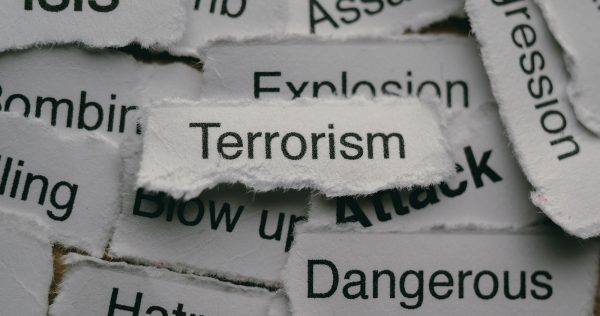 Torn paper with terrorism related words.